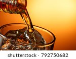 closeup of pouring whiskey... | Shutterstock . vector #792750682