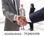 closeup.reliable handshake of... | Shutterstock . vector #792803398