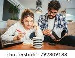 woman and man doing paperwork... | Shutterstock . vector #792809188