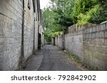 view of an inner city alley | Shutterstock . vector #792842902