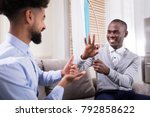 two young happy men sitting on... | Shutterstock . vector #792858622