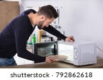 side view of a young man baking ... | Shutterstock . vector #792862618
