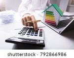 businessman calculating... | Shutterstock . vector #792866986