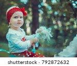 child walking in the park. | Shutterstock . vector #792872632