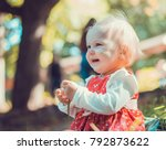 child walking in the park. | Shutterstock . vector #792873622