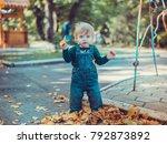 child walking in the park. | Shutterstock . vector #792873892