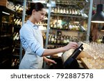 young waitress or cashier... | Shutterstock . vector #792887578