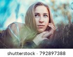a beautiful girl is resting on...   Shutterstock . vector #792897388