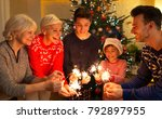 family with sparklers at... | Shutterstock . vector #792897955