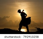 Silhouette Of A Salt Farmer...