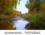 a puddle in the autumn woods. a ...   Shutterstock . vector #792918562
