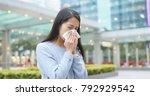 woman sneeze at outdoor city    Shutterstock . vector #792929542