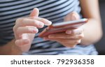 using mobile phone at home | Shutterstock . vector #792936358