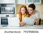 happy couple at home paying... | Shutterstock . vector #792988006