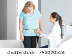 Young Female Doctor Measuring...