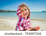 cute happy little girl eating... | Shutterstock . vector #793097242