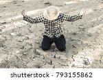 man on a drought stricken land... | Shutterstock . vector #793155862