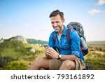 man checking map on phone while ... | Shutterstock . vector #793161892