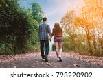 young couple holding hands and... | Shutterstock . vector #793220902