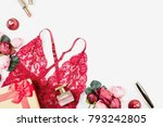 Stock photo women red lace lingerie with giftbox flowers make up items on white background copuspace 793242805