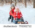 two sisters ride a sled in the... | Shutterstock . vector #793302712