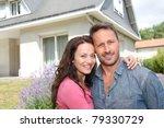 happy couple standing in front...   Shutterstock . vector #79330729