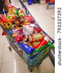 Small photo of Selangor, Malaysia - January 7, 2018: A shopping cart that is full with all kinds of grocery products showing the spending behaviour of Malaysian.