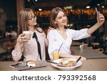 two girls having lunch in a... | Shutterstock . vector #793392568