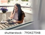 pretty girl reading a book on...   Shutterstock . vector #793427548