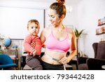 young mother in sportswear... | Shutterstock . vector #793442428