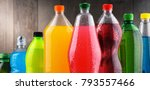 Small photo of Plastic bottles of assorted carbonated soft drinks in variety of colors