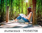 woman enjoy reading on wooden... | Shutterstock . vector #793585708