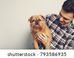 Stock photo closeup portrait handsome young hipster man kissing his good friend red dog isolated light 793586935