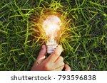 hand holding light bulb on... | Shutterstock . vector #793596838