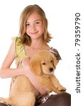 A cute young girl holding a Golden Retriever Puppy on an isolated white background - stock photo
