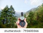 traveler with compass seeking a ... | Shutterstock . vector #793600366