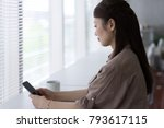 woman who operates a smartphone ...   Shutterstock . vector #793617115