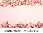Stock photo border of small dry roses on pink background place for text flat lay top view 793650112