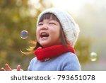 portrait of happy little asian... | Shutterstock . vector #793651078