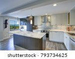 Stock photo well appointed kitchen features a large island gray quartzite countertops silver backsplash and 793734625