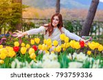 beautiful woman with tulips... | Shutterstock . vector #793759336