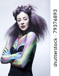 young woman in studio with body paint and hair done for hair competition - stock photo