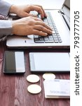 laptop with cash and bitcoin on ... | Shutterstock . vector #793777705