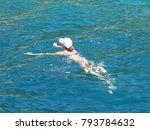 woman in sun hat swimming in... | Shutterstock . vector #793784632