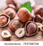 hazelnuts and hazelnut leaves... | Shutterstock . vector #793788748