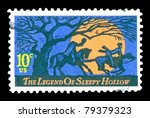 USA - CIRCA 1974: The Legend of Sleepy Hollow stamp is issued in time for Halloween.  The scene shows a headless horseman chasing Ichabod in the light of a giant orange full moon, circa 1974. - stock photo