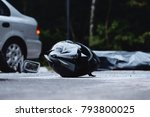 Small photo of Close-up of black motorcycle helmet. Inattentive car driver on the road with motorcyclist