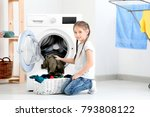 cute little girl doing laundry... | Shutterstock . vector #793808122