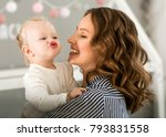 mom with daughter on her arms... | Shutterstock . vector #793831558