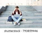 desperate student sitting on... | Shutterstock . vector #793859446